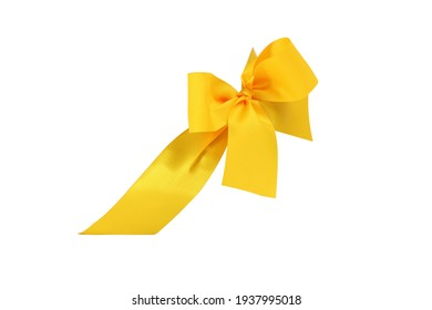 Decorative yellow ribbon and bow cut out and isolated on white background