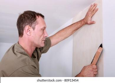 Decorator hanging wallpaper