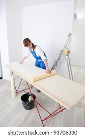 Decorator measuring wall paper