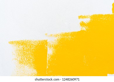Decorator's hand painting wall by the roller brush for protection and corrosion,Set of tools for painting wall at home