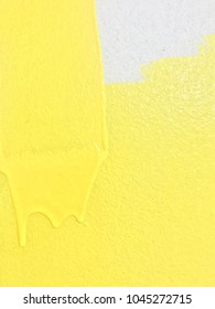 Decorator's painting wall in yellow color. Worker painting yellow color on the for home renovation. Home renovate. Decoration room by painting yellow color.