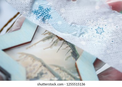 The decoupage process with the wooden Christmas decoration (blue star). Decoupage process. New year/Christmas background