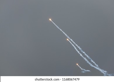 Decoy flare rockets from fighter jet. Countermeasure. Background with copy space.