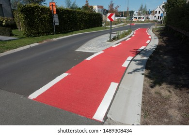 A dedicated cycle lane for bicycles only is marked in bright red with white lines on a Belgian road.Road safety feature