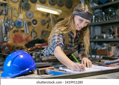 dedicated young woman working in workshop