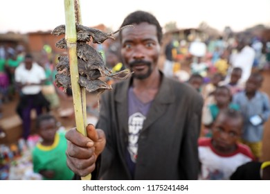 DEDZA, MALAWI - JUNE 1, 2018: Unidentified market vendor sells mice on a market in a remote village near Dedza. Malawi is one of the poorest countries in the world.