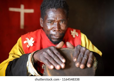 DEDZA, MALAWI - JUNE 4, 2018: Unidentified traditional healer with a drum in a remote village near Dedza. Malawi is one of the poorest countries in the world.