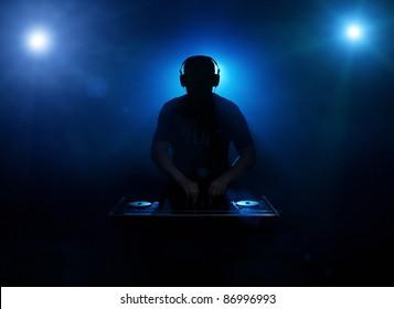 Dee jay silhouette back lit