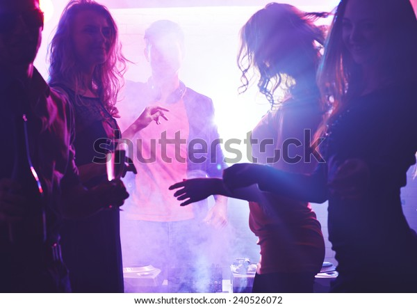 Deejay and dancing girls