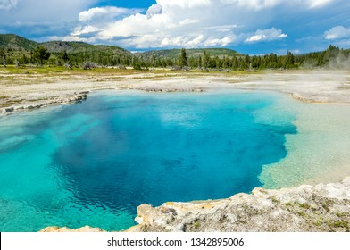 Deep beautiful Sapphire Pool of Biscuit Basin, Yellowstone national park, Wyoming, USA
