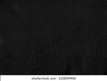 Deep black luxury genuine cow leather texture background. Close up photography of sofa, chair, interior, auto seat cover