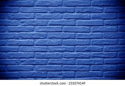 deep blue brick wall background faded on black