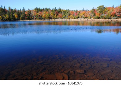Deep blue lake and Autumn foliage