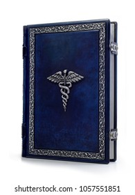 Deep blue leather bound medical book with silvered caduceus on the front cover.