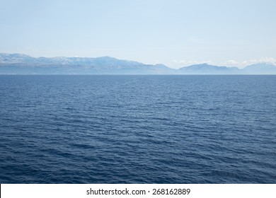 Deep blue ocean and distant land