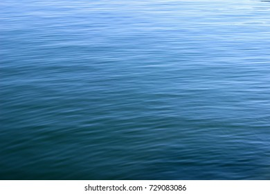 Deep blue sea water surface texture ripples abstract background horizontal