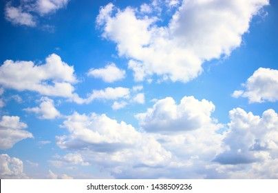 Deep blue skies with white clouds background with space for text,  blue cloudy skies texture, dark blue sky wallpaper with with white fully clouds and sunlight