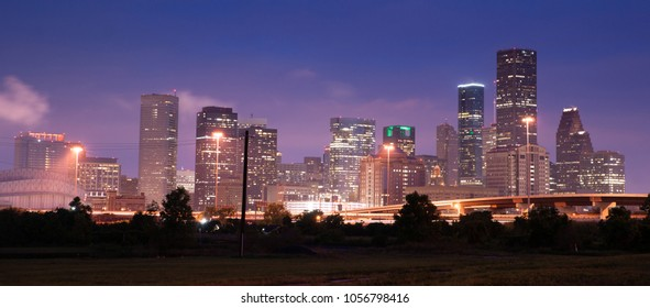 Deep blue sky after dusk as lights illumiinate the buildings of the inner city at Houston Texas USA North America