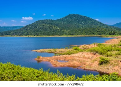 Deep blue water of Burudih lake with mountains in the backdrop at Ghatsila, Jharkhand, India