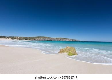 Deep blue waters and algae-covered rocks in West Bay on Kangaroo Island, Australia