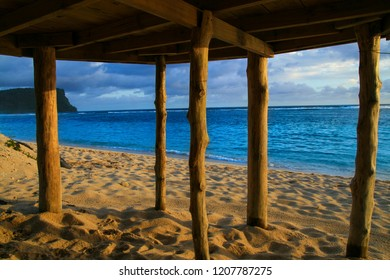 Deep blue waters of Pacific Ocean wiev through wooden pillars of beach fale - traditional Samoan house Lalomanu beach Samoa, Polynesia
