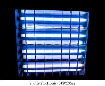 deep blue white squares with long horizontal lamps with gradient effect, dark grid against white yellow light lamps, close-up of movie illuminant, big square with horizontal lamps inside against black