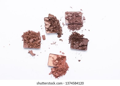Deep brown crumbled eye shadow isolated on white background.
