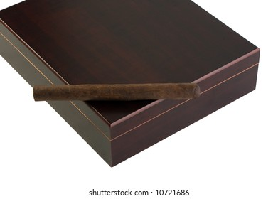 A deep brown Maduro cigar rests atop a dark cherry-wood humidor, with clipping path