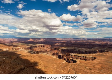 Deep canyon in the shade of clouds against a cloudy sky, Canyonlands National Park, Utah, USA