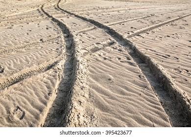 Deep car tyre tracks at the Baltic beach surface
