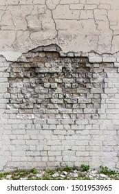 Deep crack in old brick wall - concept image. Broken wall.