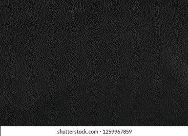 Deep dark black color luxury genuine cow leather texture background. Close up photography of sofa, chair, interior, auto seat cover