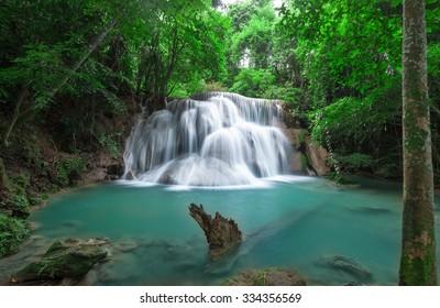 Deep forest waterfall at Huay Mae Kamin waterfall National Park Kanchanaburi Thailand