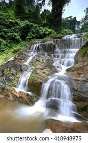 Deep forest waterfall , The waterfall named Mae Phlu waterfall in Uttaradit province , Thailand