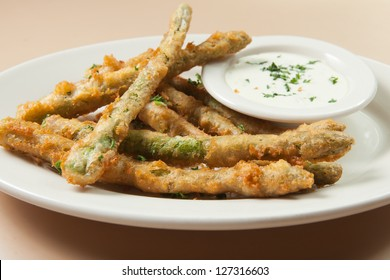 Deep fried asparagus with a dipping sauce
