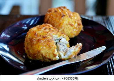 deep fried bread served with honey sauce , ice cream inside