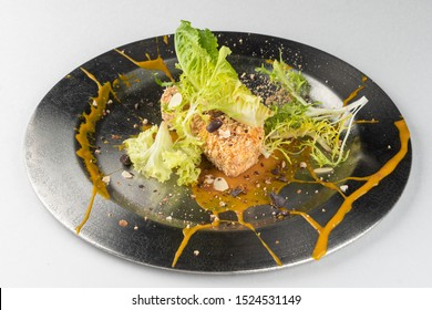Deep fried Camembert with waffle crumbs, sweet sauce, grated nuts and greens isolated on white