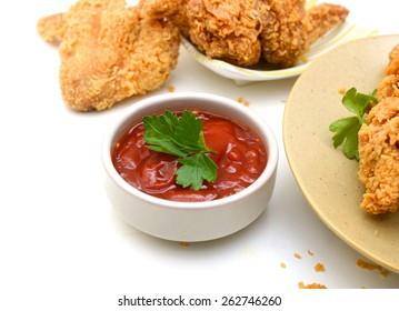 deep fried chicken with sauce on white background