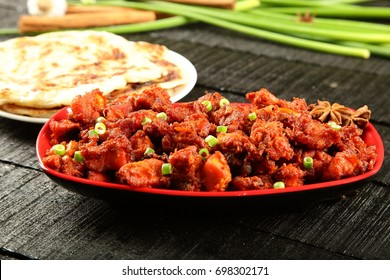 Deep fried chicken tikka masala with Nan bread