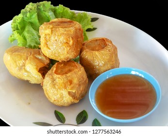 Deep Fried Crab meat roll ( Jock shell crab ) or  Hoi Jo Traditional local Chinese food for appetizer Food of Asian It is eaten .