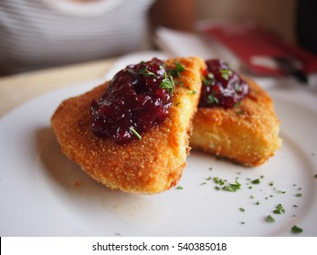 Deep fried crispy camembert cheese on the Trans-Siberian Railway, topped with a raspberry jam.