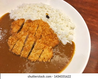 Deep fried crispy pork katsu curry over steamed rice call Japanese tonkatsu curry recipe ,which is delicious Japanese pork cutlet with creamy Japanese curry sauce as famous menu in Japanese restaurant