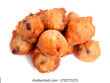 Deep fried doughnut balls also known as typical Dutch oliebollen over white background