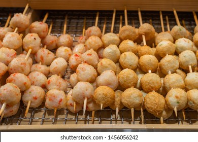 Deep fried fishball and seafood nugget on rack at night market