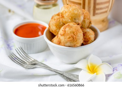 Deep fried Indonesian street food Cilok, made from tapioca and served with peanut sauce or chili sauce, Cilok Goreng