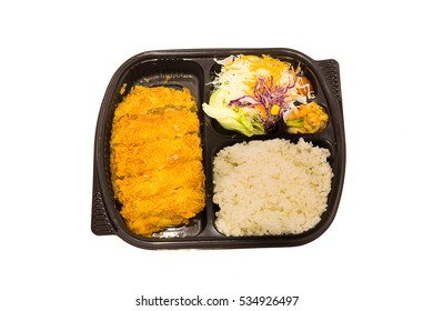 Deep fried pork (tonkutsu) bento set with fresh salad,japanese food. Top view.