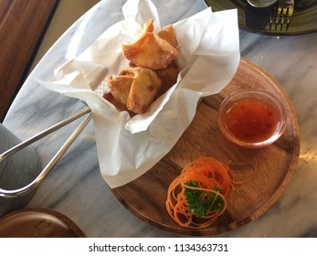 Deep fried pork wonton (eggroll wrappers) on the dish, snack