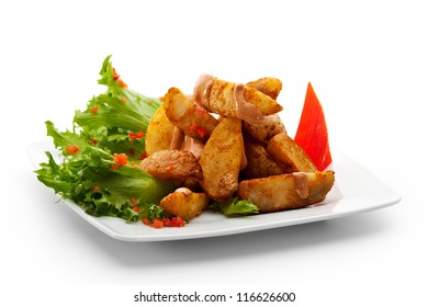 Deep Fried Potato Garnished on Salad Leaf with Parsley and Bell Pepper