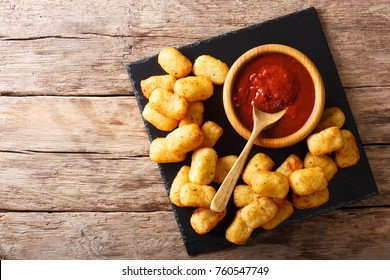 Deep fried Potato Tater Tots and ketchup close-up on the table. horizontal top view from above