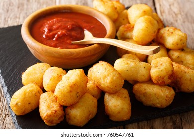 Deep fried Potato Tater Tots and ketchup close-up on the table. horizontal
